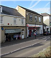 SY2998 : West Street shop between a bank and the post office, Axminster by Jaggery