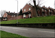 ST2896 : Brick houses and wall above Maendy Way, Cwmbran by Jaggery