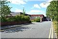 SK0405 : Tesco's delivery entrance, Kirkside Grove, Brownhills by Robin Stott
