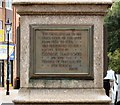 SD7109 : Plaque on the Market Cross (1) by Gerald England
