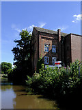 SK0418 : Canalside factory in Rugeley, Staffordshire by Roger  Kidd