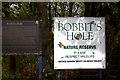 TM2531 : Bobbit's Hole signs by Robert Eva