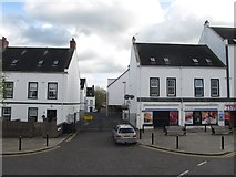 J4569 : Businesses on the south side of The Square, Comber by Eric Jones
