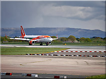 SJ8184 : easyJet A320 at Manchester Airport by David Dixon