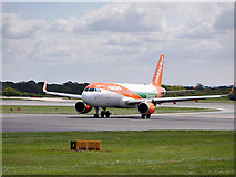 SJ8184 : Airbus A320 at Manchester Airport by David Dixon