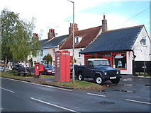 TM2222 : Elizabeth II postbox and telephone box on The Street. Kirby-le-Soken by JThomas