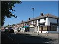 SJ4792 : Shops, Warrington Road by Sue Adair
