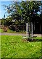 SO6026 : Metal bench around a tree near Brampton Abbotts Village Hall, Herefordshire by Jaggery
