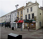 SS9079 : Boarded-up town centre shop behind a signpost, Bridgend by Jaggery