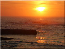 SW3526 : Sunset over the breakwater at Sennen Cove by Rod Allday