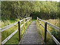 NY2061 : Boardwalk across wet grassland area by Rose and Trev Clough