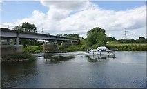 SK8174 : Cruising boat passes under Dunham Toll Bridge by Russel Wills