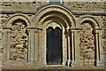 SP8526 : Stewkley, St. Michael's Church: The Norman triple-arched west door with zig-zag carving by Michael Garlick