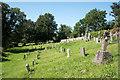 NY5218 : Graveyard at Bampton Grange by Trevor Littlewood