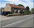 ST6980 : Row of four houses at the northern edge of Westerleigh by Jaggery