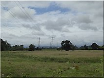 SX9792 : Power lines in the valley of the River Clyst by David Smith