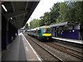 SP0581 : Train speeding through Bournville station by Richard Vince