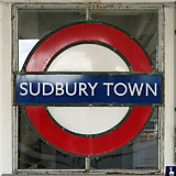TQ1684 : Sudbury Town tube station - enamel roundel in window by Mike Quinn
