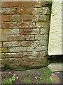 SY1387 : OS benchmark - Sidmouth, St Kilda Lodge by Richard Law