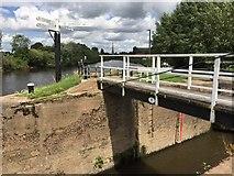 SO8453 : Swing bridge and signpost by Alan Hughes