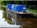 SJ6049 : Canal maintenance boat near Ravensmoor, Cheshire by Roger  Kidd