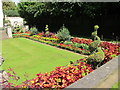 TQ2782 : The Holme, formal garden with bedding plants and topiary by David Hawgood