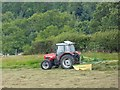 NY9358 : Turning the hay at High Staples Farm by Oliver Dixon