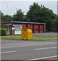 SS9079 : Yellow donations bin outside Bridgend Fire Station by Jaggery