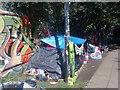TQ2984 : Tent beside Regents Canal by David Anstiss