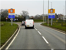 SJ2618 : Entering the Roundabout at Four Crosses by David Dixon