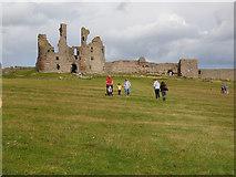 NU2521 : Approaching Dunstanburgh Castle  by Stephen Craven