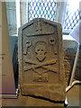 NU1019 : St Maurice, Eglingham - skull and crossbones by Stephen Craven