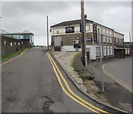 SS7597 : Road to Neath railway station past The Arch by Jaggery