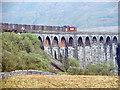SD7579 : A freight train crossing Ribblehead Viaduct by John Lucas