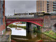 SJ8297 : Metrolink Tram Crossing the Viaduct near Cornbrook by David Dixon