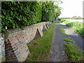 TQ5208 : Boundary Wall at Cobb Court by PAUL FARMER