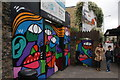 TQ2984 : View of street art next to the railway bridge on Camden Street : Week 38