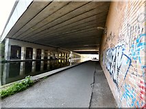 SJ7993 : Canal and motorway by Gerald England