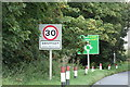 TF8207 : Roadsign & Swaffham Town Name sign by Adrian Cable