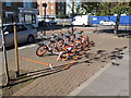 TQ2081 : Cycle hire Mobikes  by Acton Main Line Station by David Hawgood