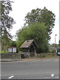 SK2572 : The lych gate of Baslow church by David Smith
