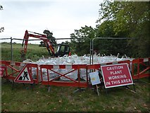 SO8843 : Bags of aggregate in Croome Park by Philip Halling