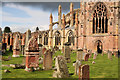 NT5434 : Melrose Abbey and graveyard by Walter Baxter
