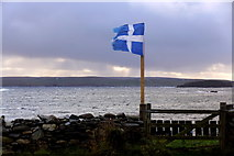 HP5605 : Shetland flag outside the cottage at Westing beach by Mike Pennington