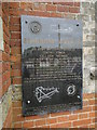 TF9607 : Shipdham Airfield memorial on the cemetery chapel by Adrian S Pye