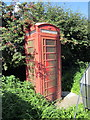 SJ3079 : Disused telephone box, Upper Raby Road by Jeff Buck