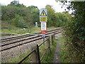 TQ3199 : Foot crossing over the railway by Marathon