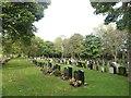 NZ3364 : Lines of headstones, Jarrow Cemetery by Graham Robson