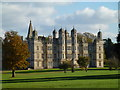 TF0406 : Burghley House on a sunny Autumnal day by Richard Humphrey