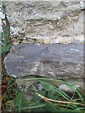 SH5968 : Damaged rivet benchmark on St Mary's Church Hall, Tregarth by Meirion